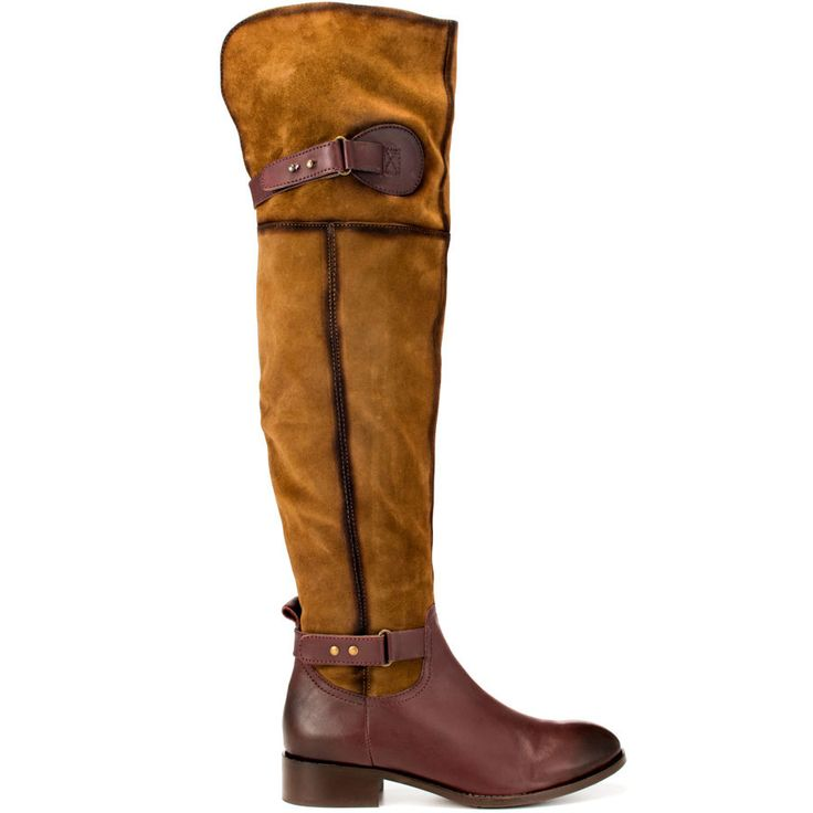We'll make a bet that you'll be the hottest in the Fifty Fifty.  This Luichiny boot brings you casual everyday fashion at its finest; A gorgeous brown suede combines with a burgundy leather to create the upper.  A 1 1/4 inch block heel and buckle details completes this wearable boot.