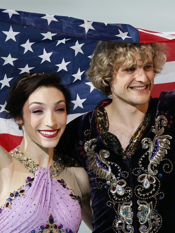 Charlie White and Meryl Davis of the United States celebrate their ice dancing gold medal. First ever ice dancing gold for the US! I adore Charlie and Meryl...they are perfect together