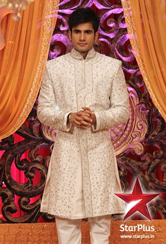 Viren looks smart and sophisticated in a white jodhpuri.