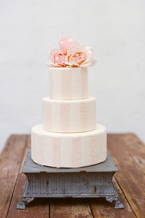 Soft pink and white striped wedding cake