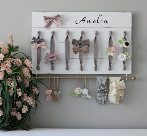 Brand New Listing! XL Personalized Hair Bow Holder Headband Organizer  Turn you daughters bow collection into a work of art with this original, handmade organizer. Its the perfect way to both organize and display your bows and headbands beautifully in any nursery, girls room or bathroom. The grey ribbon allows for a simple, elegant place to clip all your bows and barrettes. Each high quality wood plank is hand-cut, painted, distressed and sealed for a beautiful smooth finish. I hand select…