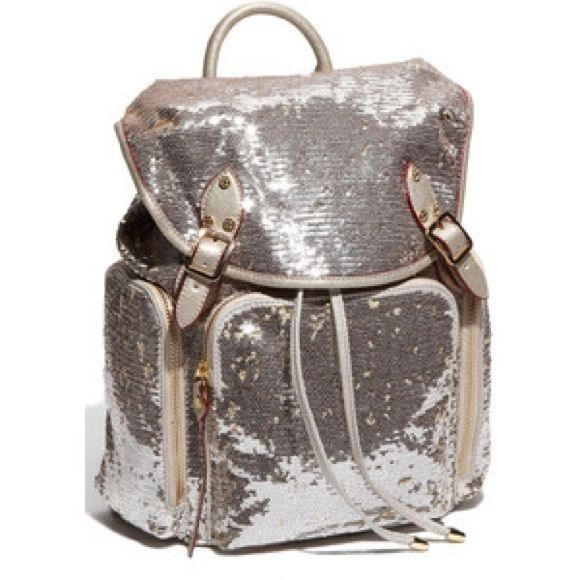BRAND NEW SILVER SEQUIN BACKPACK This gorgeous silver sequin backpack can be used as a purse or for books for school! Never been used. Comes with two side pockets one front pocket and a zipper pocket and with 2 additional pockets inside. It has draw strings to tie or easy magentic buttons to close! Has two straps on the back to wear on shouldars and a handle on top! No trades, PayPal, or low ball offers! I accept reasonable offers and offer discounted bundles!  listed VS for exposure…