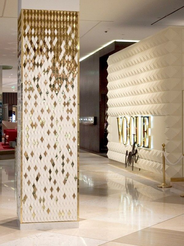 Diamond Columns, Dubai Mall  A specially designed diamond with an angled face was arrayed to convey falling golden gradients of colour in the studio's third installation for the Dubai Mall.  The columns are composed of ceramic tiles in both matt white and high gloss gold finish, angled in varying directions to show reflect shimmering light in the surface. - Giles Miller Studio