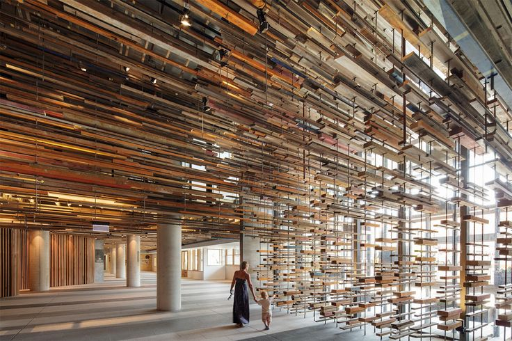 Stunning Entryway of the Nishi Building Includes a Suspended Ceiling of 2,150 Reclaimed Boards from Old Homes and a Basketball Court http://www.thisiscolossal.com/2014/05/nishi-building/