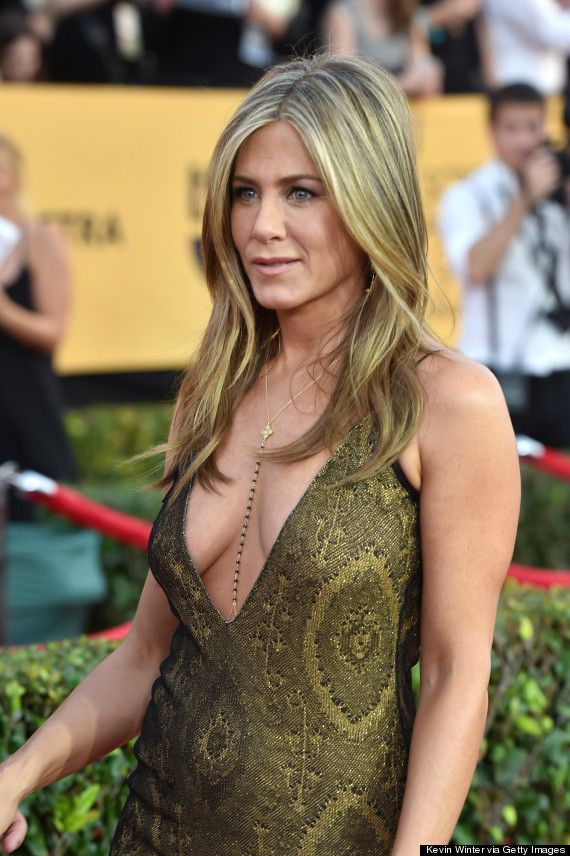 Jennifer Aniston stuns in this plunging gold dress