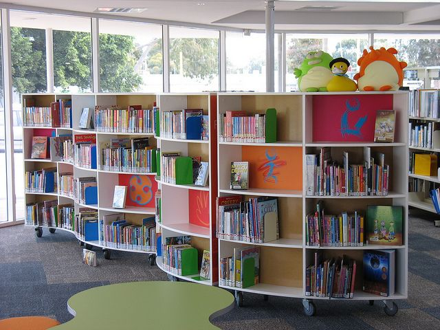 Shelves on wheels for flexible space. New curved shelves in children's library @ Coolbellup Library by Cockburn Libraries, via Flickr