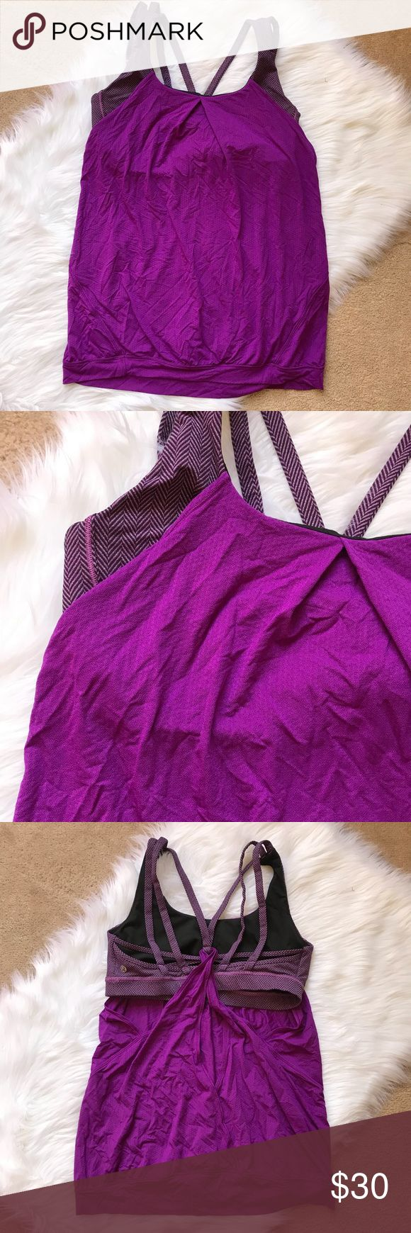 Lululemon Twist Back Tank 12 Lululemon Tank.  Size 12.  Twist open back.  Attached strappy sports bra.  RIDICULOUSLY CUTE!  Solid purple with patterned purple sports bra.  Does not have removable cups.   EUC - no stains, tears or pulls.  Hand washed, hung dry.  Crispy size tag has been removed. lululemon athletica Tops Tank Tops