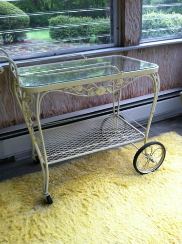 Woodard tea cart  offered on eBay starting at $150.00  or buy-it-now for $350.00