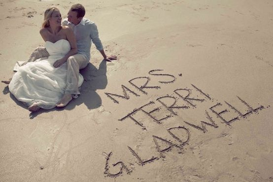 Trace my new name in the sand on our honeymoon and get a pic of Tim and I sitting beside it. I like this idea.