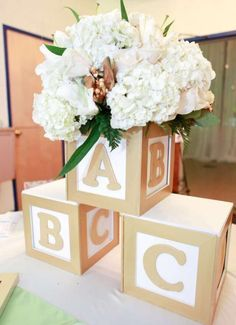 Baby blocks baby shower party centerpiece! See more party planning ideas at CatchMyParty.com!