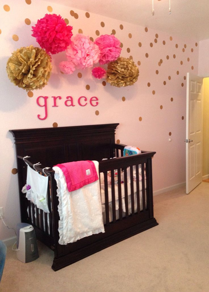 Baby girl pink nursery with gold polka dots made with contact paper and cricut