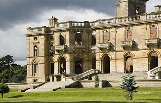 The ruins of Witley Court, Worcestershire. The house was remodelled with extensive additions by Samuel Daukes, c1855-9, for Lord Ward (Earl of Dudley 1860), one of the richest men in England. The church and portico were left untouched, but the rest of the house was encased in palatial Italian Renaissance facades. After a major fire in 1937 the house was abandoned and fell into ruin.