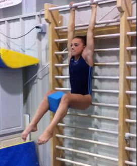 Working the Core, Low Back, and Inner Thigh Using Stall Bars | Gymnastics News Network