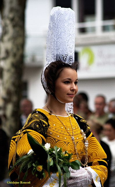 This is a traditional dress from Brittany, principally in the Bigoudène part of the region.