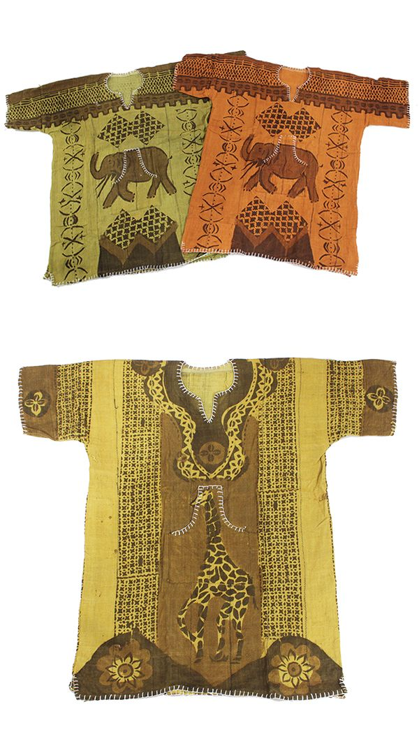 African Mud Cloth Dashiki - Beautiful African dashiki shirt with African animals hand painted in traditional African colors.  Bold handmade African dashikis made in Mali.  Celebrate African culture and history with these beautiful African dashiki shirts with giraffes and elephants.  #giraffes #elephants #african #africa #animals #dashikis #pattern #style #blachistorymonth #blackhistory