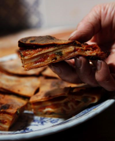 """Gambino Winery - Sicilian Food - Don't sweat the folding technique for this chewy, tomato and cheese pie. """"The uglier your scaccia looks, the better it tastes,"""" says Roberta Corradin, who gave us this recipe for Scaccia Ragusana."""
