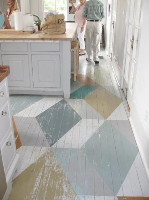 DIY: How to Paint Wood or Concrete Floors - using Farrow & Ball Floor Paint, painter's tape and a stencil. This post has a free chevron floor stencil template available to download + creative design ideas - distressed geometric designs, contemporary designs, etc. - Ryle and Company