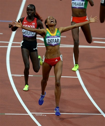 Ethiopia's Meseret Defar has won the gold medal in the women's 5000m final at the Olympic Stadium, London (© EMPICS Sport)