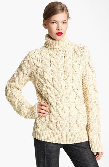 Chunky knit sweater. Pair it with skinny jeans and boots or Chuck Taylors. Classic look.