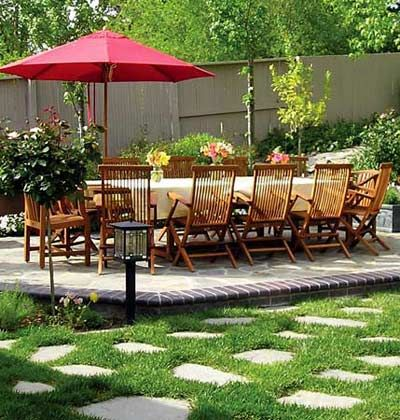 Casual Garden Patio    Balmy summer evenings invite dining outdoors. Whether you opt for a small family gathering or supper for a crowd, a casual garden setting calls for relaxed seating. This Walnut Creek, California yard boasts a 12- by 20-foot brick-edged flagstone patio -- large enough to comfortably seat 12 or more.  Garden design: Matthew and Joan Lane, Proscape Landscaping, Walnut Creek,