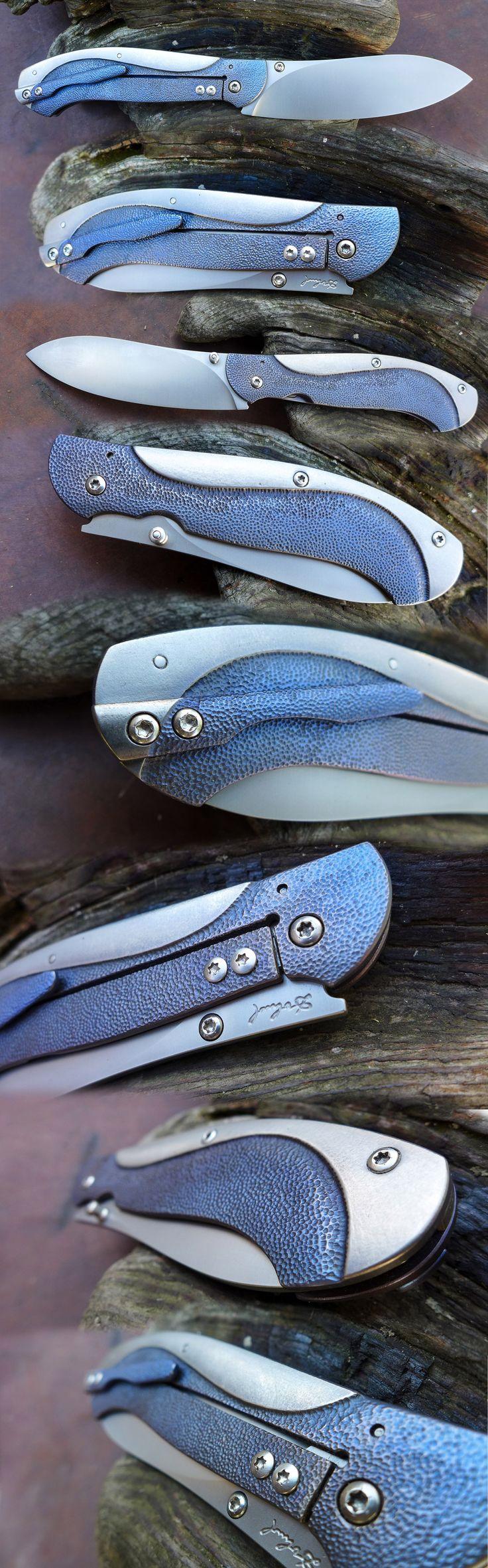 Framelock. Elmax blade, blue titanium.