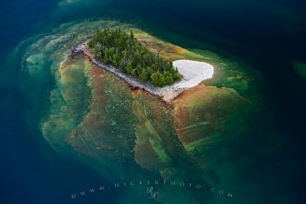 The base of an island fans out beneath the surface of Lake Superior in Ontario and disappears to the dark depths of this great lake. >>> Amazing!