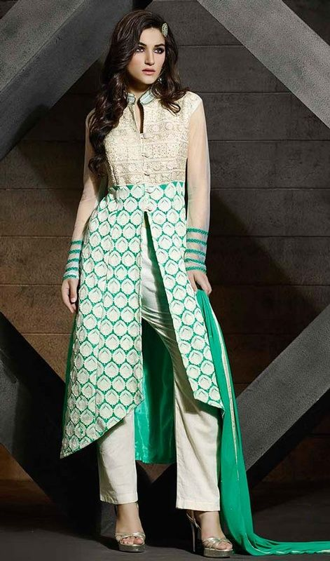 Trot in style with this green and cream color net embroidered pant style suit. This pretty attire is displaying some terrific embroidery done with lace, resham and sequins work. #netsalwarkameez #netdresses #pantstylesuits