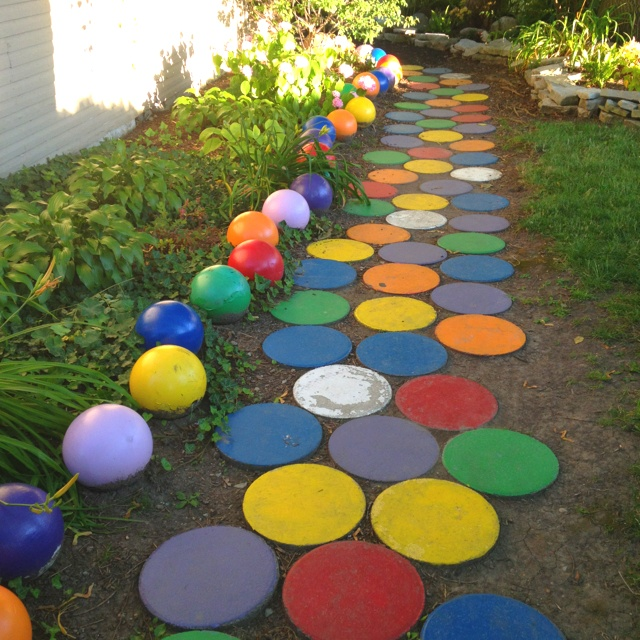 Gum ball walkway, painted bowling balls and pavers. Love it!