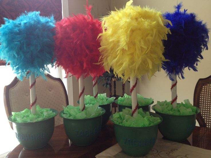 Dr. Seuss trees. Styrofoam balls wrapped with a boa and mounted on a painted wooden rod.  I made these as centerpieces for my sons first birthday. I ordered paper cutouts of Dr. Seuss characters and I will place on top on pot.
