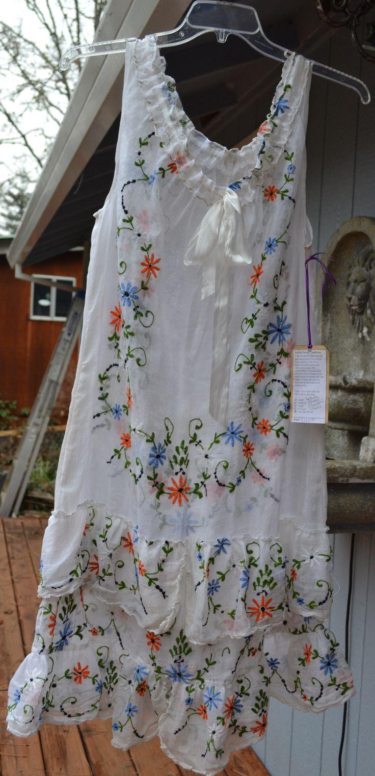 Long ruffled Tablecloth dress. Has silk ribbon draw string neckline.