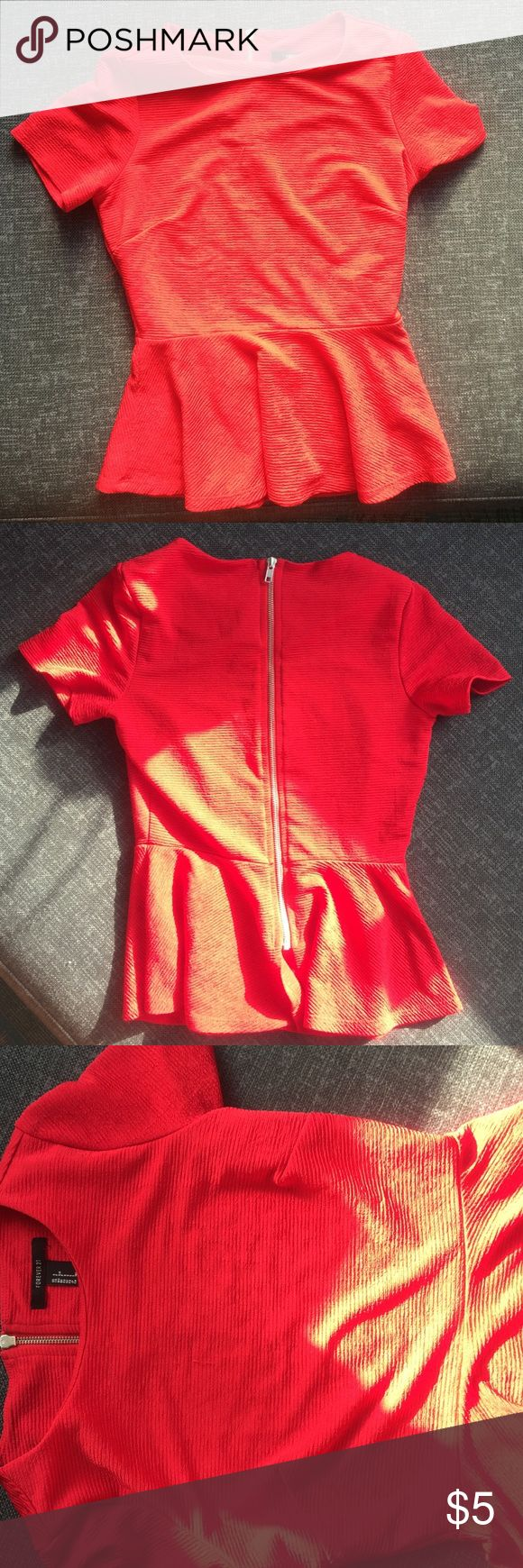 Red peplum top with zipper back Red peplum top. Exposed zipper back. Good condition Forever 21 Tops