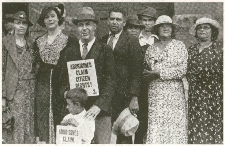 Group of Aborigines with protest sign.  From the collections of the State Library of NSW.