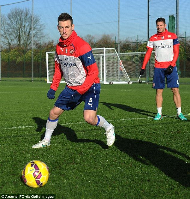 Laurent Koscielny goes for the ball during Arsenal's training session ahead of facing Manc...