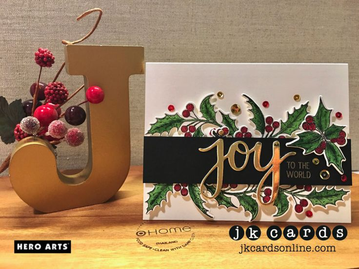 Golden Watercolor Holly. Hero Arts Holly Days Stamp & Cut Photopolymer, Hero Arts Joy Stamp & Cut Photopolymer, Hero Arts Gold Embossing Powder, Mijello Mission Gold Watercolor, The Paper Cut Gold Mirror Card, Pretty Pink Posh Gold and Metallic Red Sequins.