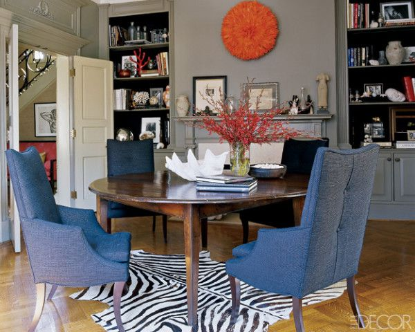 RJones chairs are grouped around an antique dining table from Liza Sherman Antiques; the African headdress is a flea-market find.