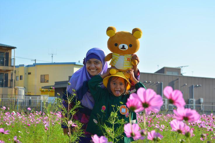 My wife and daughter at cosmos garden, Kariya-shi, Japan.