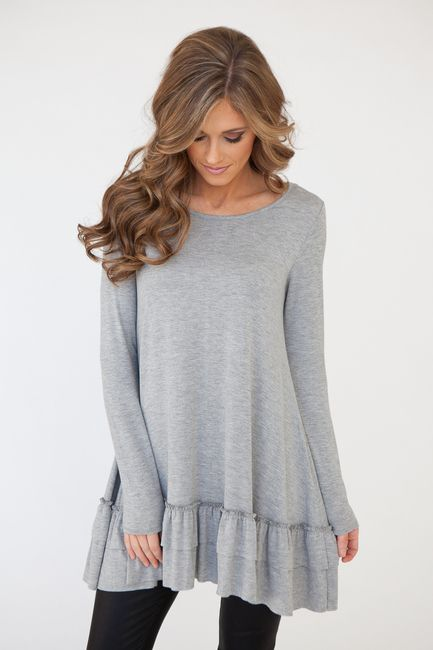 Shop our Solid long sleeve knit tunic with adorable ruffle hem. Free Shipping on…