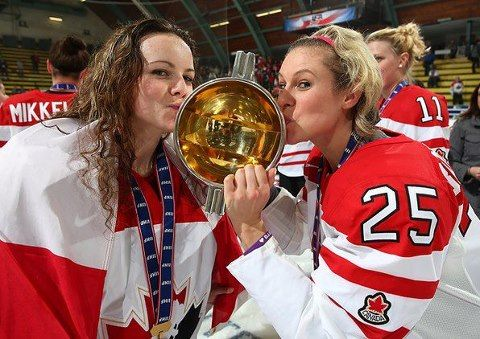 Kissing the cup! Shannon Szabados and Tessa Bonhomme