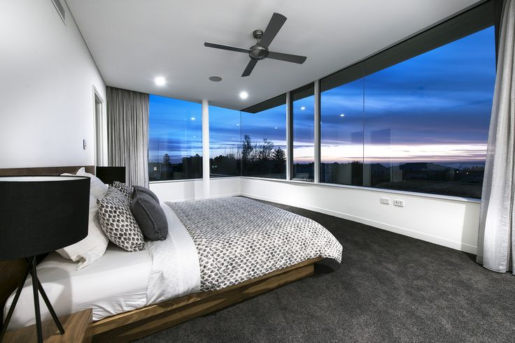 With clean lines and a minimalist aesthetic, there's a distinct resort feel to this home design, created to complement the sweeping coastal views and unique topography of our client's City Beach block. Entry | Coastal Home | Contemporary | Luxury | Custom Home | Master Bedroom