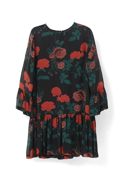 Loose fitted dress with three-quarter sleeves,  frill details and a zipper on the back. <br /><br />Model  is 175cm tall and wearing a size small/ 36.