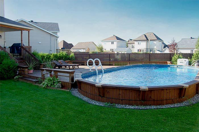 24 Above Ground Pools You Ll Want In Your Backyard Oval Pool Pool Landscaping In Ground Pools