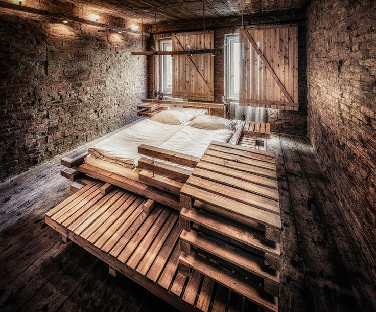 heri&salli builds giant timber bed frame for viennese guest room