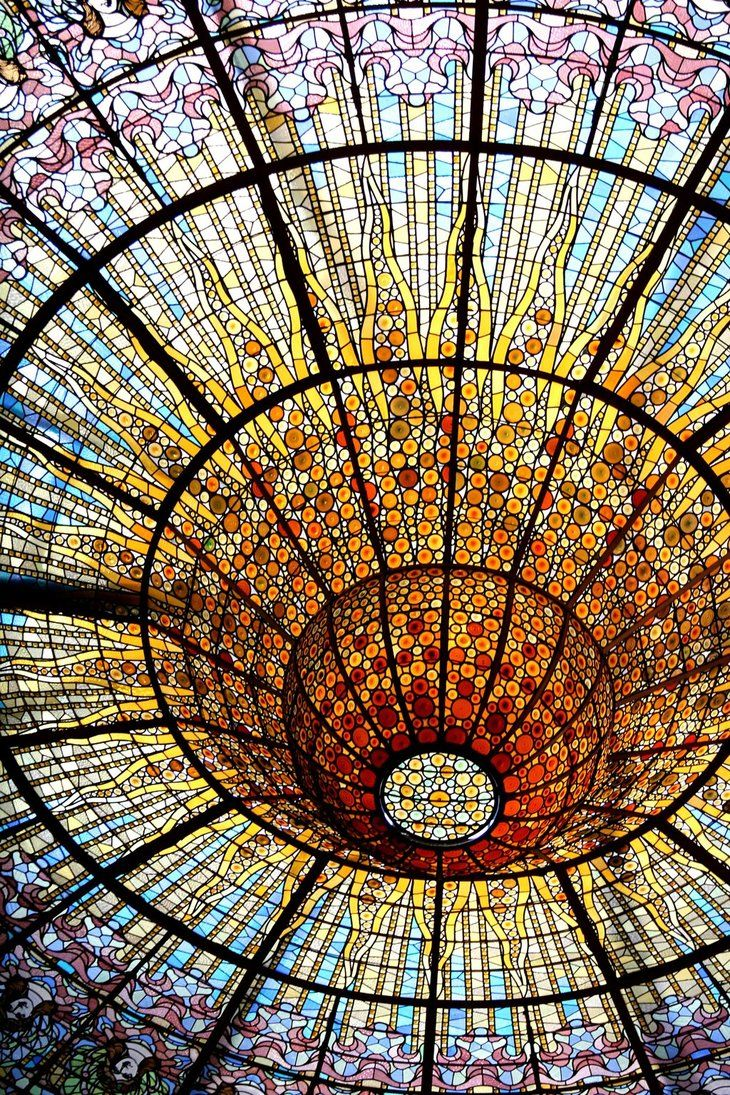 Mind-blowingly intricate stained glass roof, operabuilding in Barcelona. Palau de la Musica Catalana