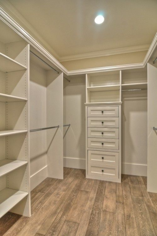 Love this walk in wardrobe.... So much storage and beautiful wood flooring!