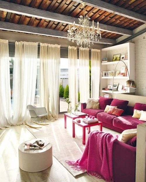 wood beams, bookshelves, long floaty curtains, chandelier, brick wall, velvet sofa, midcentury chair. I love everything in this.