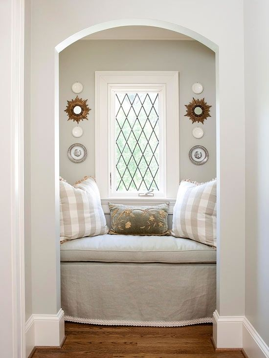 Cozy Reading Nook - I don't have a space like this in my house but I really like the décor on each side of the windows