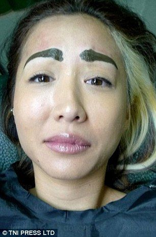 A woman with tattooed eyebrows