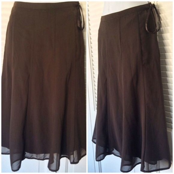 H&M dressy, brown, flowy skirt, with ribbon tie H&M dressy, brown, flowy skirt, with ribbon tie, size 4. 100% polyester. EUC. H&M Skirts