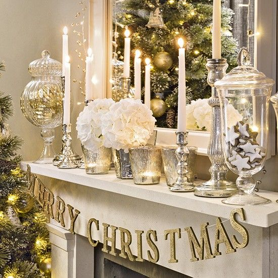 Christmas living room with silver and gold mantel display                                                                                                                                                                                 More