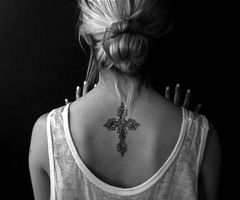 Love the idea of using a vintage or antique cross for a tattoo and I love the placement, but on a much smaller scale...